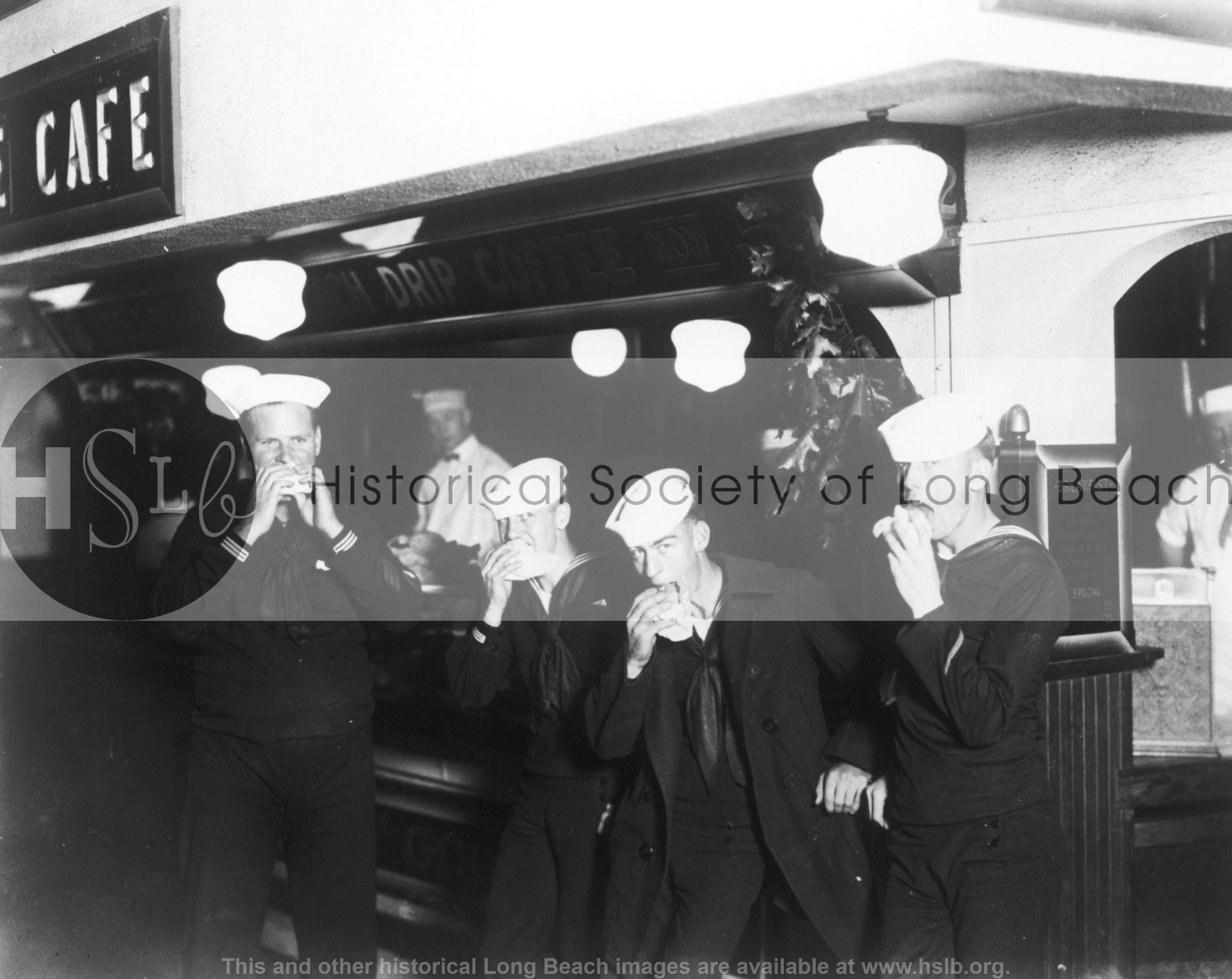Sailors eating burgers, 1937 vintage photograph