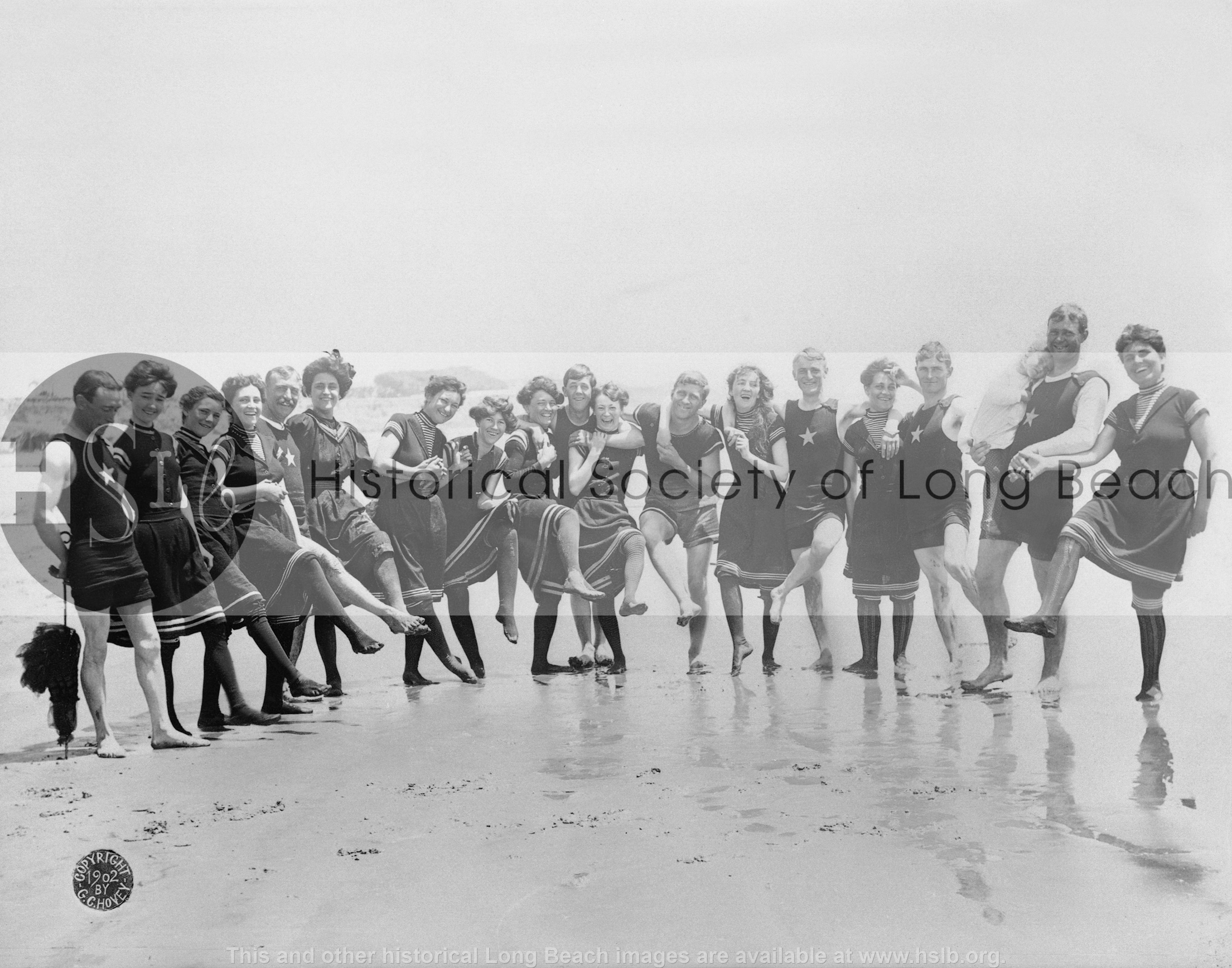 Bathers on beach, 1902 vintage photograph