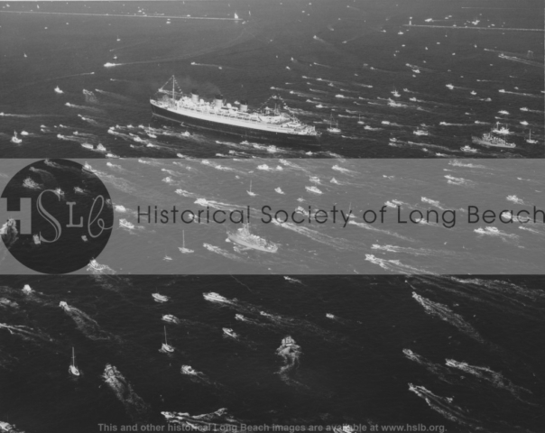 Queen Mary escorted into Long Beach, 1967