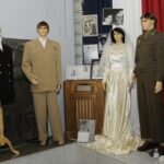 Pearl harbor manikins in costume at opening reception
