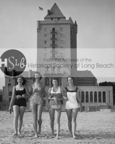 Young women on the beach at the Pacific Coats Club, c. 1950