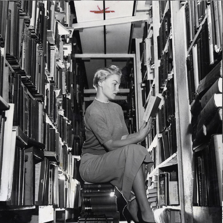 HSLB photo collection woman reading in library