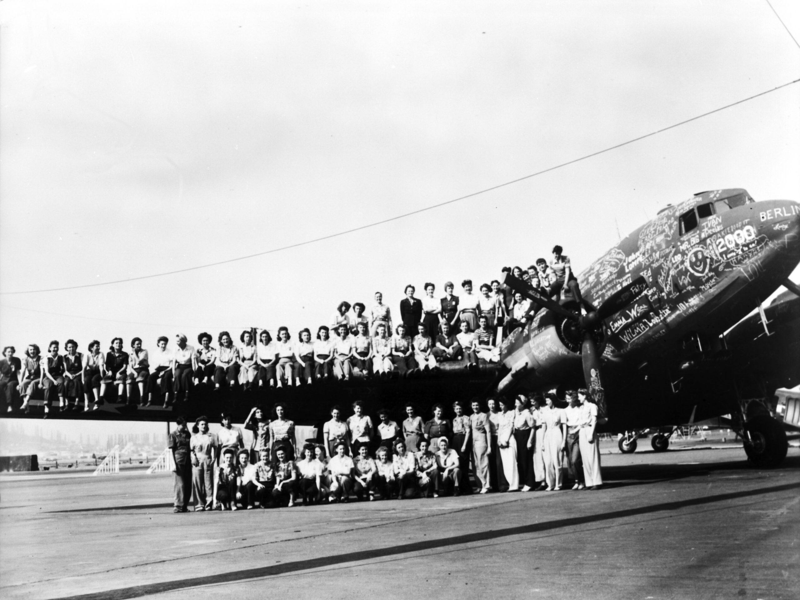 Douglas crew sitting on airplane wing