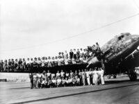 Douglas crew sitting on plane wing