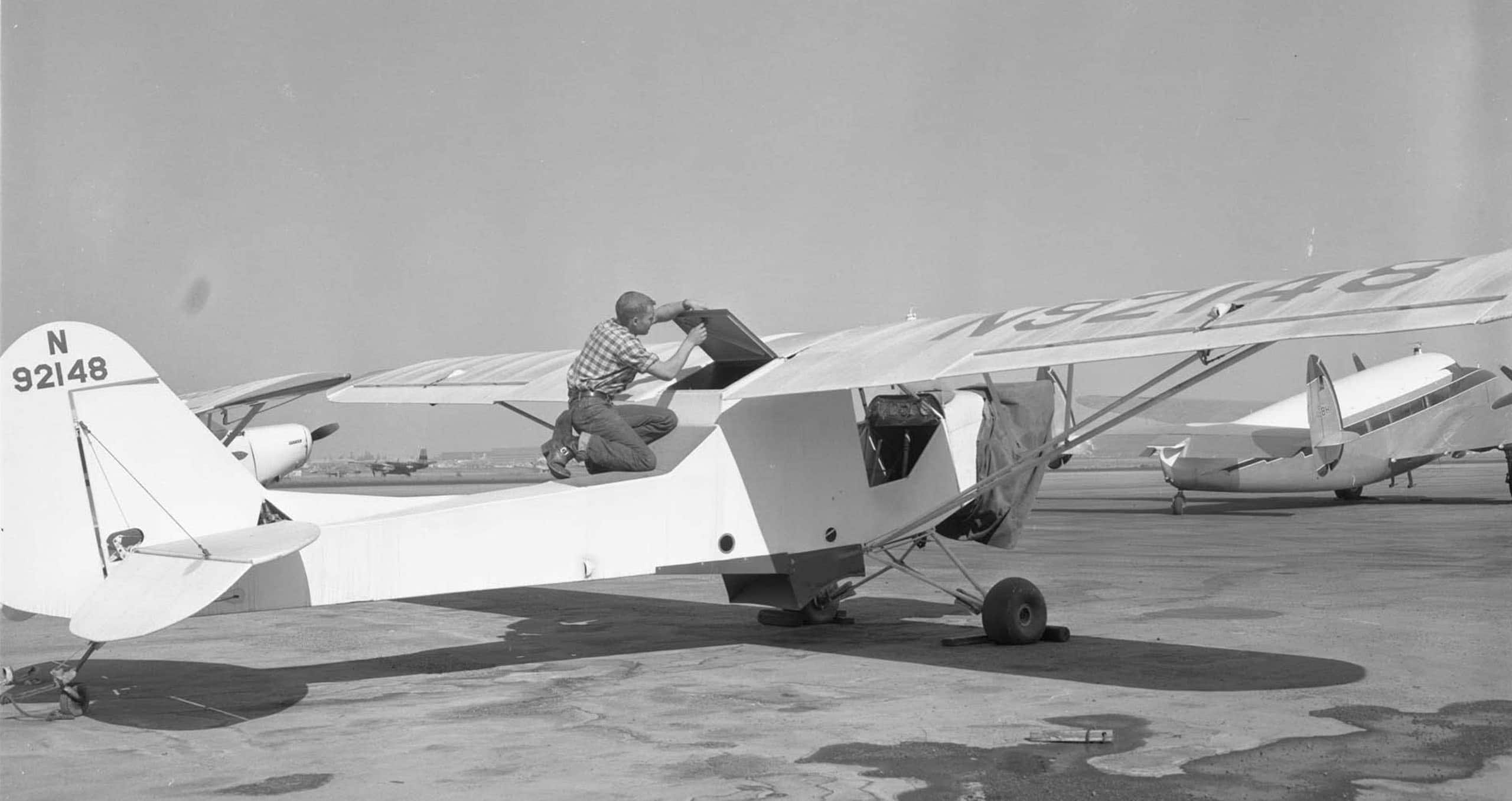Man working on airplane long beach airport
