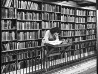 Woman in the library reading vintage long beach