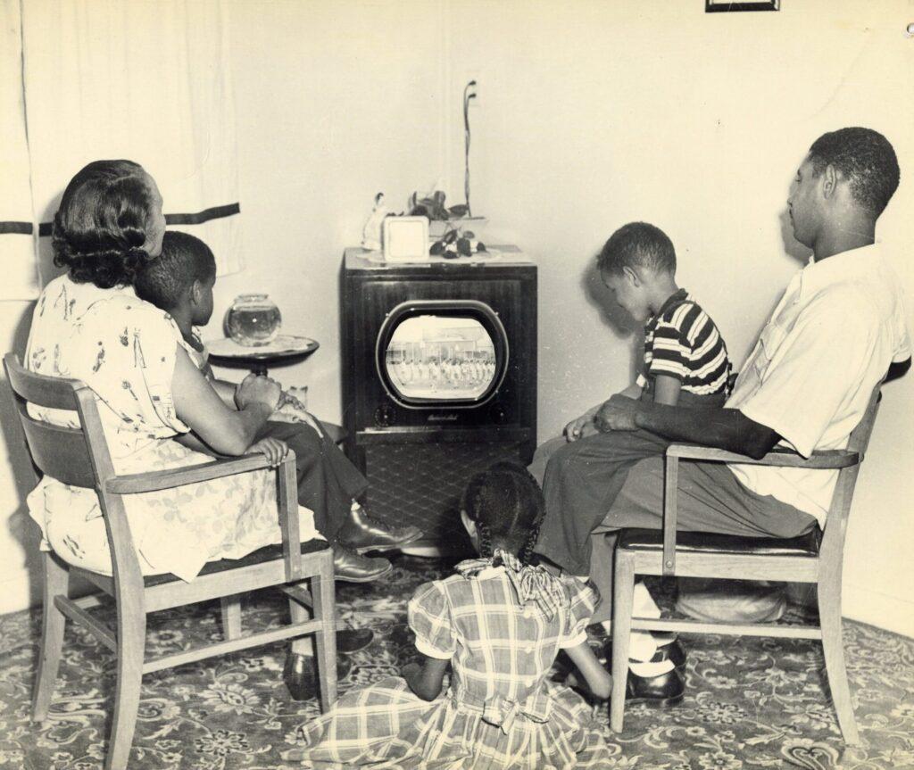 Vintage family watching tv in Livingroom